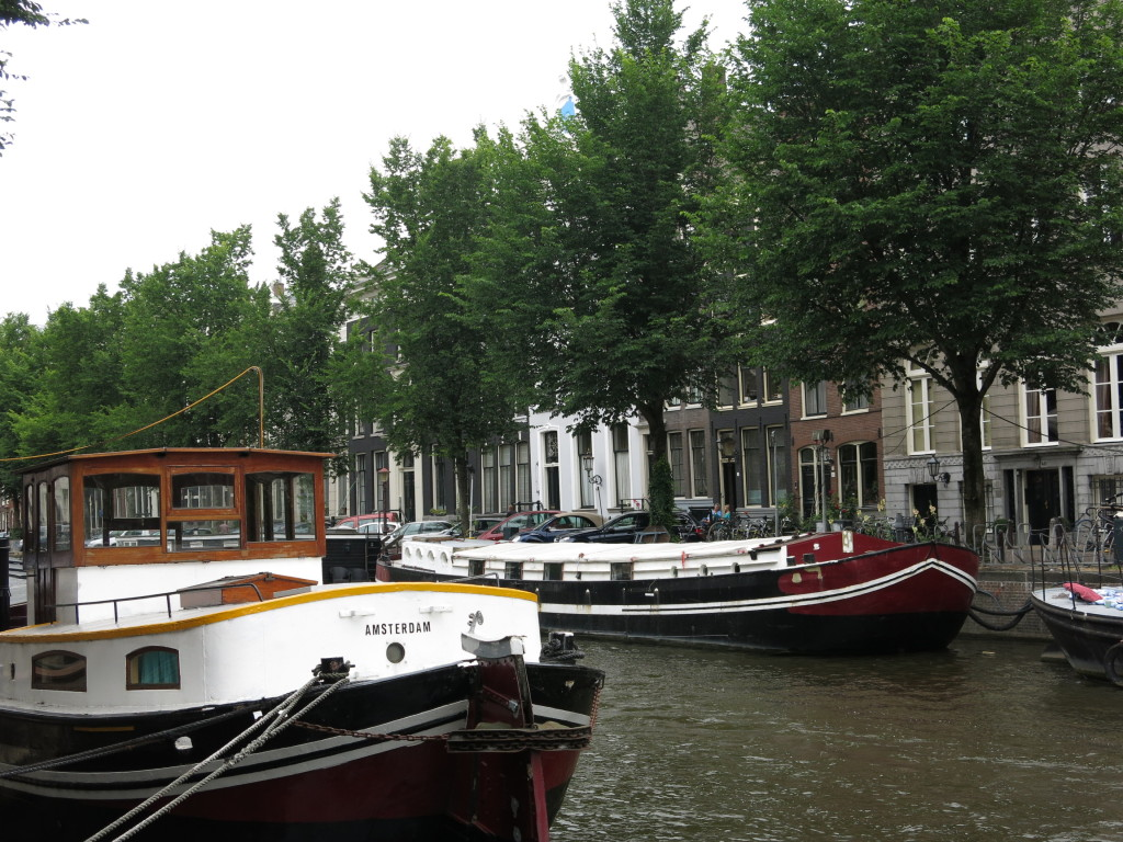 Boats on canal in Amsterdam
